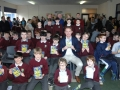 Daniel Hardiman who officially launched the quiz book with pupils from St. Patrick's Primary School.